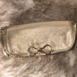 Cole Haan gold wallet , magnet clasp